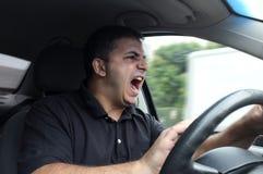 Homem irritado que conduz um veículo Imagens de Stock Royalty Free