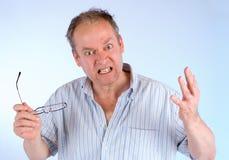 Homem irritado sobre algo Imagens de Stock Royalty Free