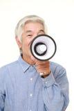 Homem japonês superior com megafone Fotos de Stock