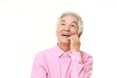 Homem japonês superior que sonha em seu future  Fotos de Stock Royalty Free