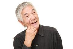 Homem japonês superior que sonha em seu future  Foto de Stock