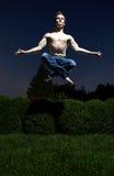 Homem Levitating Imagem de Stock