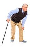 Homem maduro com uma dor do joelho Fotografia de Stock Royalty Free