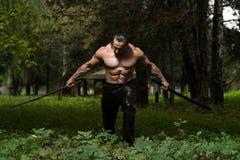 Homem maduro na ação com espada Fotografia de Stock Royalty Free