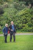 Homem mais idoso que anda com mãe fotografia de stock royalty free