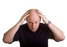 Homem mais idoso que mostra a cabeça calva Fotografia de Stock Royalty Free