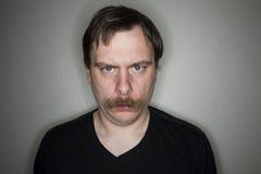 Homem mal-humorado Fotografia de Stock