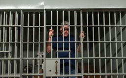 Homem mau, cadeia, prisioneiro, condenado fotos de stock royalty free
