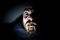 Homem monstruoso com dentes longos Fotografia de Stock Royalty Free
