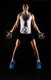Homem muscular de salto Imagem de Stock Royalty Free