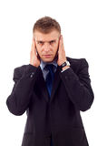 Homem na audição nenhum pose mau Imagem de Stock Royalty Free