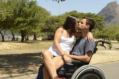 Homem na cadeira de rodas e na amiga foto de stock royalty free