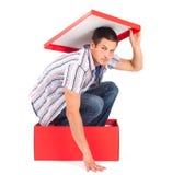 Homem na caixa Fotos de Stock