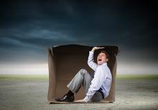 Homem na caixa Fotografia de Stock