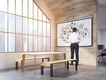 Homem na cantina do escritório com cartaz Imagens de Stock