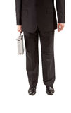 Homem na mala de viagem da prata da terra arrendada do terno Imagem de Stock