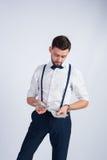 Homem na moda com um pacote de dólares novos Imagens de Stock