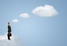 Homem na nuvem fotografia de stock royalty free