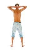 Homem nas calças de brim Fotografia de Stock Royalty Free