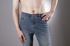 Homem nas calças de brim Imagens de Stock