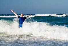 Homem nas ondas Imagens de Stock Royalty Free