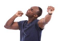 Homem negro considerável excitado com excitamento fotos de stock