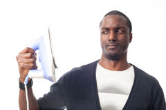 Homem negro preocupado com um ferro Imagens de Stock