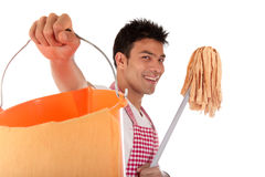 Homem nepalês novo de sorriso, housework foto de stock royalty free