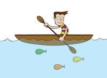 Homem no barco a remos Fotografia de Stock Royalty Free