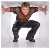 Homem no cubo Foto de Stock Royalty Free