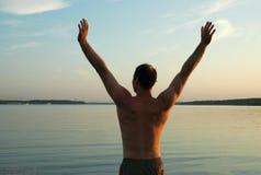 Homem no lago Imagens de Stock