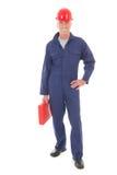 Homem no macacão azul com mala de viagem vermelha Fotografia de Stock