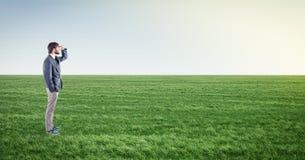 Homem no prado Imagens de Stock
