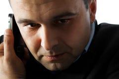Homem no telefone de pilha Imagem de Stock