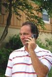 Homem no telefone de pilha Imagem de Stock Royalty Free