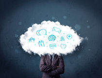 Homem no terno com cabeça da nuvem e ícones azuis Fotografia de Stock Royalty Free