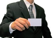 Homem no terno com cartão de visita Fotografia de Stock