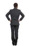 Homem no terno com mãos na correia Imagem de Stock