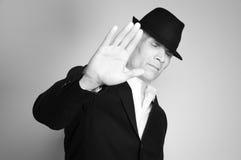 Homem no terno e no chapéu negro Imagem de Stock Royalty Free