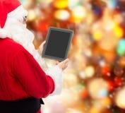 Homem no traje de Papai Noel com PC da tabuleta Fotografia de Stock