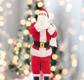 Homem no traje de Papai Noel com saco Imagens de Stock Royalty Free