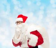 Homem no traje de Papai Noel com saco Foto de Stock Royalty Free