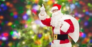 Homem no traje de Papai Noel com saco Foto de Stock
