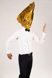 Homem no triângulo dourado fotografia de stock