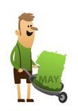 Homem no verde com um carrinho de mão Fotos de Stock