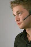 Homem nos auriculares Fotos de Stock