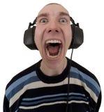 Homem nos fones de ouvido que grita canções fotos de stock