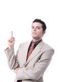 Homem novo atrativo que aponta acima de seu dedo Fotografia de Stock
