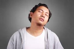 Homem novo cansado, Dizzy Gesture imagens de stock royalty free