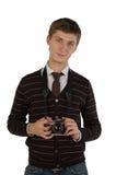 Homem novo com câmera retro Fotografia de Stock Royalty Free